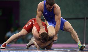 Мужской спорт: тяжелая атлетика и борьба